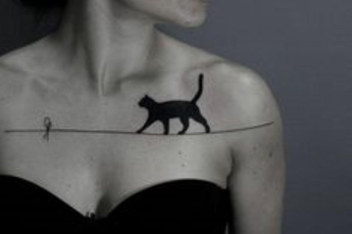 tatoo-gatto-che-cammina-sul-filo