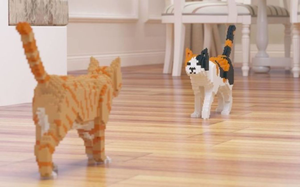 gatti-di-lego-uno-di-fronte-all'altro