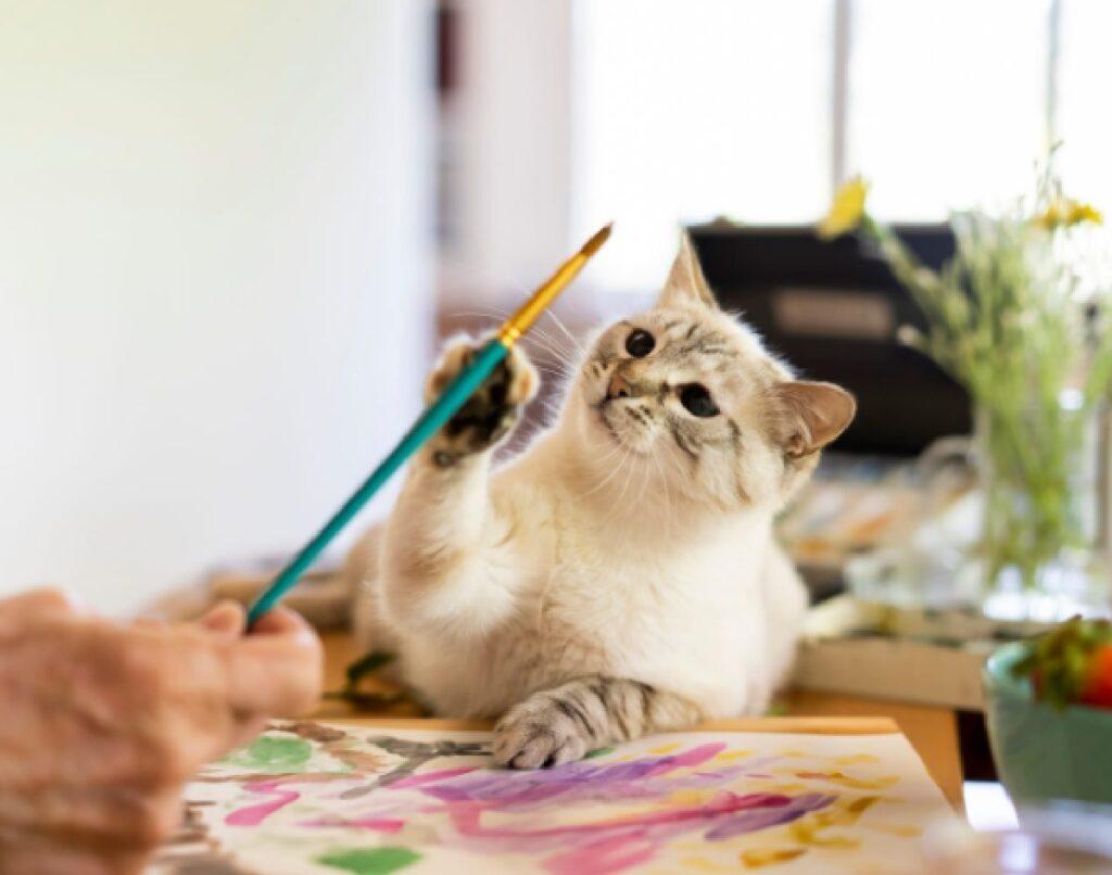 gatto vuole darsi alla pittura