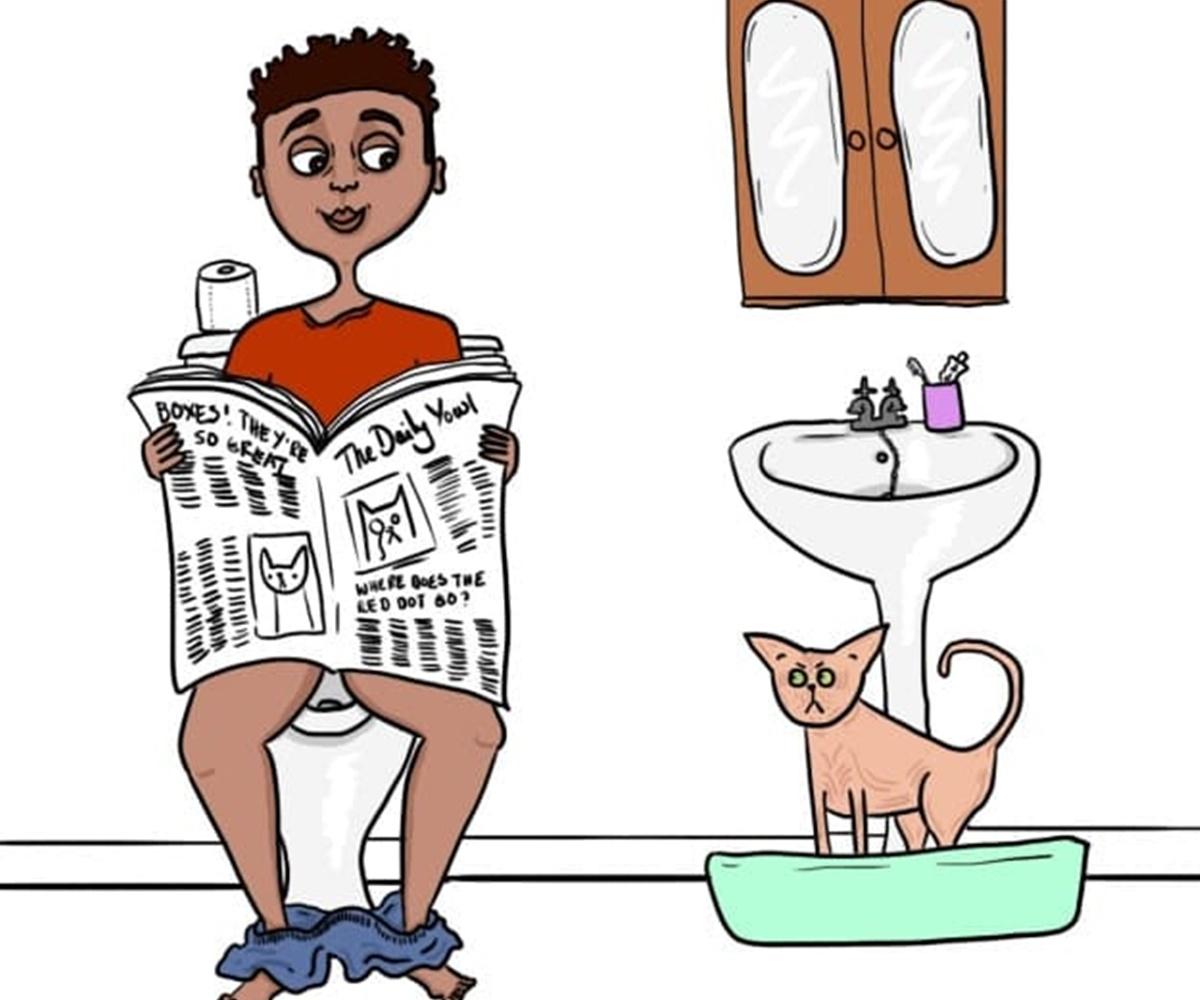 padrone in bagno con gatto
