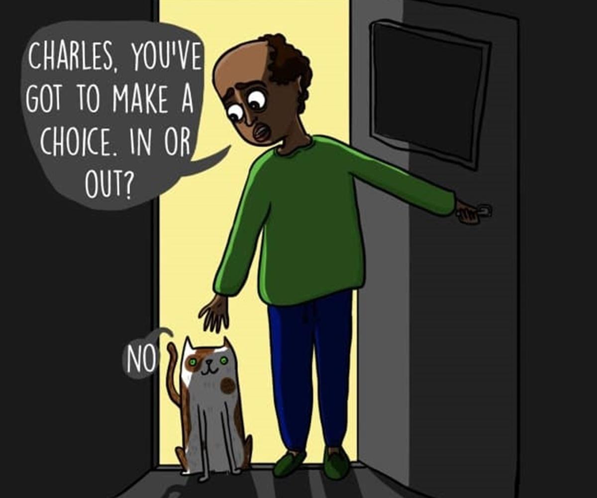 padrone sulla porta con gatto